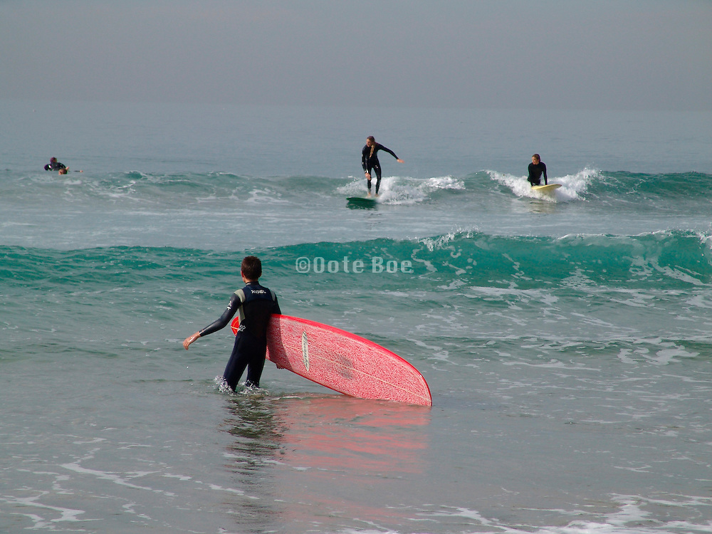 Surfer joining his friends in riding the waves.