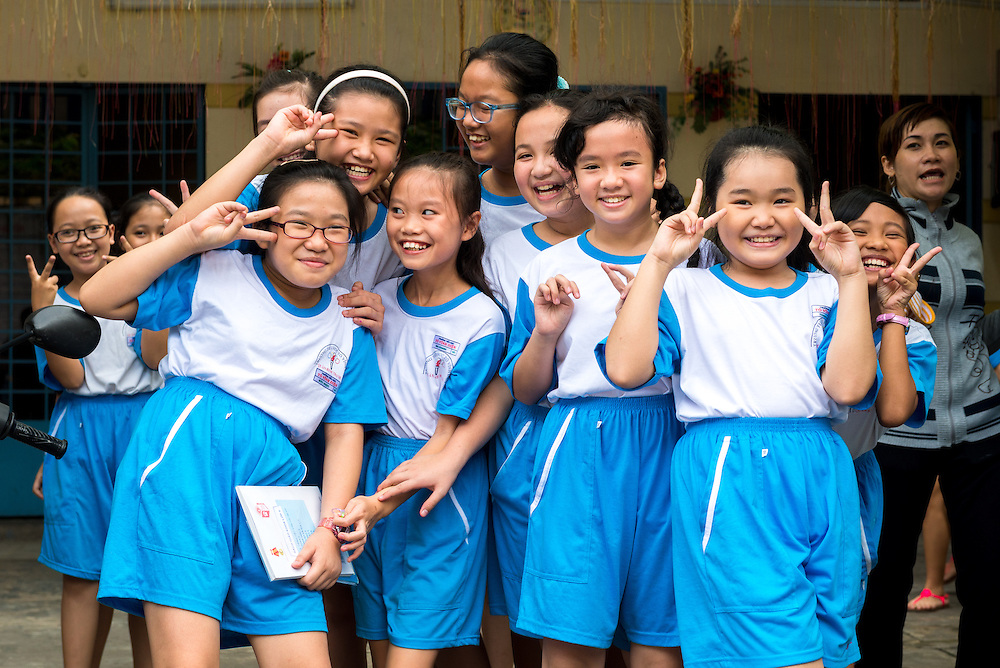 Group of Vietnamese school girls pose for the camera