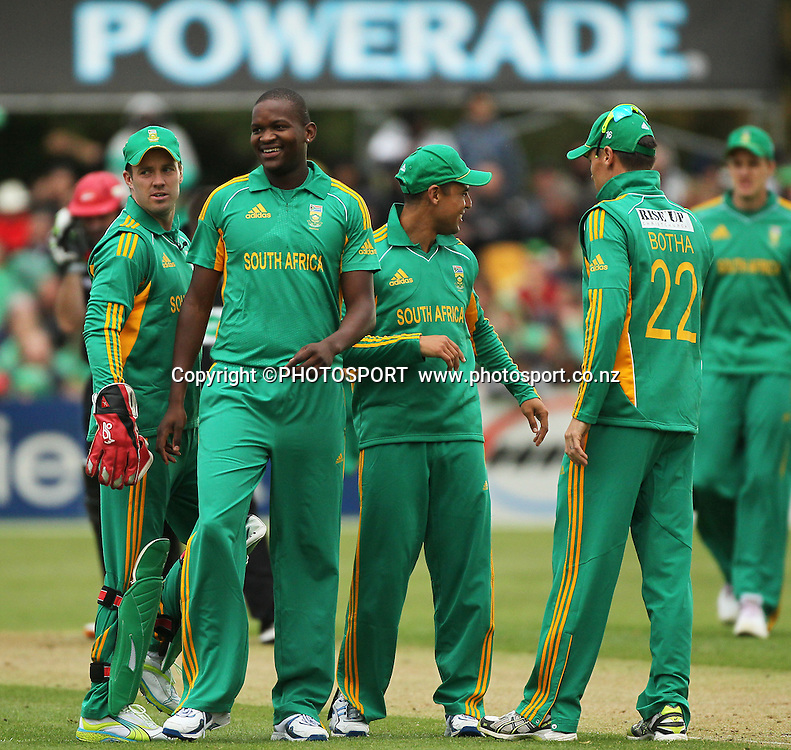 South African Lonwabo Tsotsobe celebrates with team mates after removing Peter Fulton. The last wicket being Shanan Stewart LBW, he is congratulated by Justin Ontong and JP Duminy. Canterbury Wizards v South Africa. International Twenty20 cricket match, Hagley Oval, Wednesday 15 February 2012. Photo : Joseph Johnson / photosport.co.nz