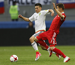 June 24, 2017 - Kazan, Russia - Dmitry Poloz (R) of Russia national team and Hirving Lozano of Mexico national team vie for the ball during the Group A - FIFA Confederations Cup Russia 2017 match between Russia and Mexico at Kazan Arena on June 24, 2017 in Kazan, Russia. (Credit Image: © Mike Kireev/NurPhoto via ZUMA Press)