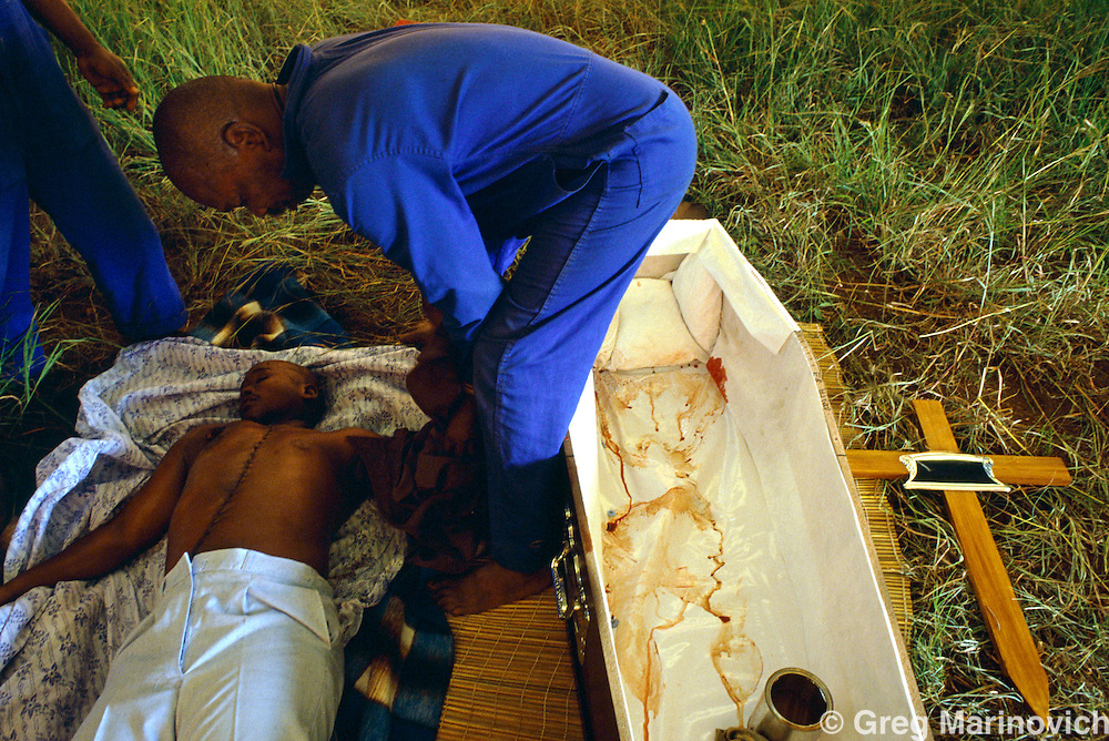 Table Mountain, KwaZulu Natal, South Africa, 1993: The body of a man killed in ANC IFP clashes in the Midlands of KwaZulu Natal is prepared for burial.