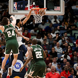 Mar 12, 2019; New Orleans, LA, USA; New Orleans Pelicans forward Anthony Davis (23) dunks over Milwaukee Bucks guard Pat Connaughton (24) during the second half at the Smoothie King Center. Mandatory Credit: Derick E. Hingle-USA TODAY Sports