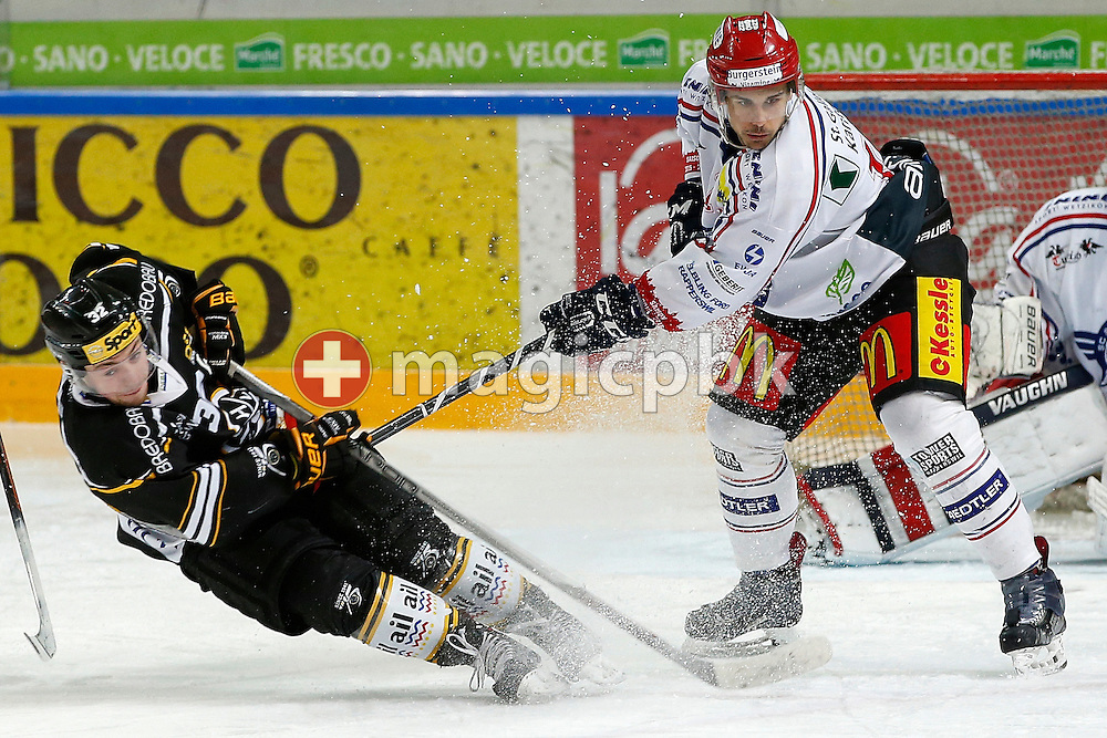Rapperswil-Jona Lakers defenseman Pascal Blaser (R) against HC Lugano player Loic Vedova during an Elite A Ranking Round 9-13 ice hockey game between HC Lugano and Rapperswil-Jona Lakers held at the Pista Resega Arena in Porza / Lugano, Switzerland, Friday, March 18, 2016. (Photo by Patrick B. Kraemer / MAGICPBK)
