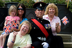 Colour Sgt Leon Egbury with left to right his niece Olivia Sanders, Youngest Sister Rachael Sanders. Eldest Sister Andrea Egbury and Mum Marcia Egbury Freedom Parade 3rd Battalion The Yorkshire Regiment Barnsley South Yorkshire  22 June 2010 .Images © Paul David Drabble.