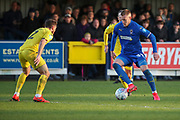 AFC Wimbledon striker Joe Pigott (39) taking on Fleetwood Town defender Lewis Coyle (2) during the EFL Sky Bet League 1 match between AFC Wimbledon and Fleetwood Town at the Cherry Red Records Stadium, Kingston, England on 8 February 2020.