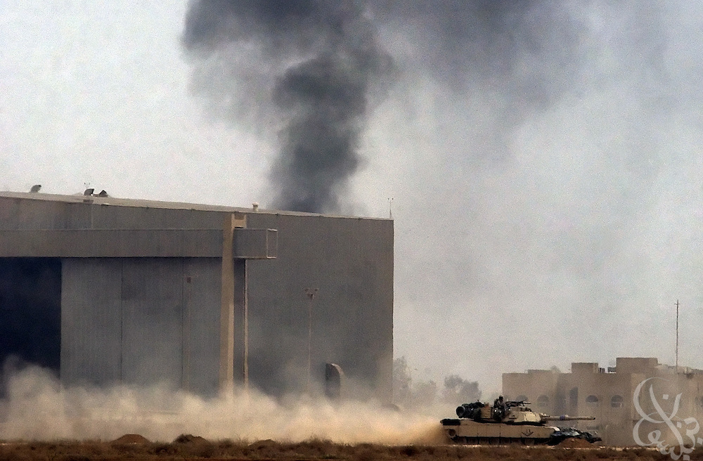 A U.S. Army 3rd Division tank rolls across the tarmac of Baghdad International airport during an allied advance April 4, 2003 on the Iraqi capital. U.S. and Iraqi forces exchanged heavy fire throughout the day as they battled for control of the strategic facility.