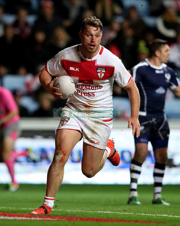 England's Elliott Whitehead runs in to score his side's second try of the game during the Four Nations match at the Ricoh Arena, Coventry.
