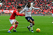 Daniel Johnson (11) of Preston North End holds off Liam Walsh (12) of Bristol City during the EFL Sky Bet Championship match between Bristol City and Preston North End at Ashton Gate, Bristol, England on 10 November 2018.