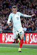 England forward, Jamie Vardy (11) dribbling during the Friendly International match between England and Portugal at Wembley Stadium, London, England on 2 June 2016. Photo by Matthew Redman.