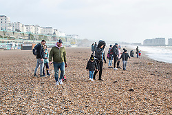 © Licensed to London News Pictures. 12/01/2020. Brighton, UK. Members of the public take advantage of the sunny and milder weather and head out the beach in Brighton and Hove. Photo credit: Hugo Michiels/LNP