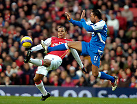 Photo: Ed Godden/Sportsbeat Images.<br /> Arsenal v Wigan Athletic. The Barclays Premiership. 11/02/2007. Arsenal's Gilberto (L), is tackled by Denny Landzaat.