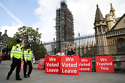 © Licensed to London News Pictures. 01/10/2019. London, UK. Police officers walk past pro-Brexit protesters as they demonstrate outside Houses of Parliament with thirty days remaining until Brexit Day. It has been reported that Prime Minster Boris Johnson has asked EU to rule out a further Brexit extension as part of a proposed new deal for the UK's departure from the bloc.Photo credit: Dinendra Haria/LNP