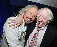 Barry Gibb and Robert Stigwood. The Silver Clef Lunch 2013 in aid of  Nordoff Robbins held at the London Hilton, Park Lane, London.<br /> Friday, June 28, 2013 (Photo/John Marshall JME)