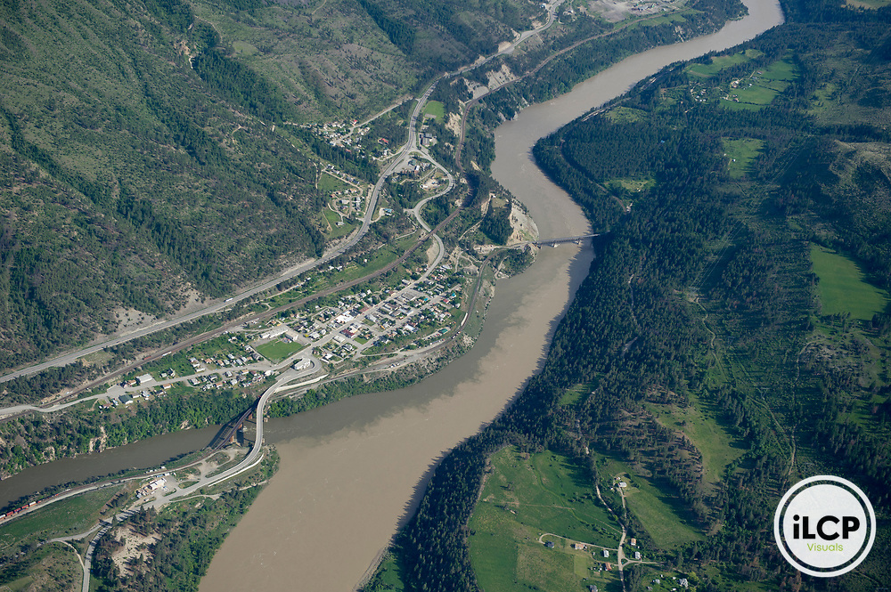 The Fraser's largest tributary is the Thompson River, which meets the Fraser main stem at Lytton. The mixing of the two rivers (darker Thompson water at right) is clearly visible from the air.