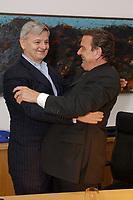 23 SEP 2002, BERLIN/GERMANY, 00:21 h:<br /> Gerhard Schroeder (R), SPD, Bundeskanzler, begruesst Joschka Fischer (L), B90/Gruene, Bundesaussenminister, herzlich in seinem Buero in der Nacht zum 23. September 2002, Wahlabend der Bundestagswahl 2002, Willi-Brandt-Haus <br /> IMAGE: 20020922-01-093<br /> KEYWORDS: Gerhard Schröder, Wahlabend 2002,