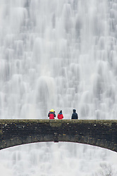 © London News Pictures. 28/12/2015, Elan Valley, near Rhayader, Powys, Wales, UK. After weeks of heavy rain the waters dramatically cascade over the top the Caban Coch dam in the Elan Valley, west of Rhayader Powys Mid Wales.  According to a spokesman in the nearby visitor centre , a billion litres of water flow over the lip of the dam every day. Photo credit: Keith Morris/LNP