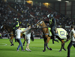 A Mindless fan hit's a police horse as he (the horse) attempts to escort fans from the pitch   - Photo mandatory by-line: Joe Meredith/JMP - Tel: Mobile: 07966 386802 04/09/2013 - SPORT - FOOTBALL -  Ashton Gate - Bristol - Bristol City V Bristol Rovers - Johnstone Paint Trophy - First Round - Bristol Derby