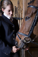 Female horseback rider with horse