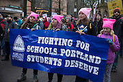 Labor groups met Saturday morning and then marched to join the tens of thousands of people who turned out in steady rain for the  Women's March on Portland on Jan. 21, 2016 on the streets of downtown Portland, Ore. The march was held in support of a national women's march held in Washington, D.C.  Photo by Randy L. Rasmussen, © 2017.