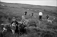 """""""MERRYMAN', OWNED BY J. AND C. CRONE WINS THE ARKLETON CHALLENGE CUP AND THE HOLMWOOD CUP, THE BLUE RIBBON EVENT OF THE HOUND TRAIL RACING SEASON. LANGHOLM, 28.07.00 THE DOG IS PRESENTED WITH THE WINNING TICKET BY STEVEN HOTSON, LANGHOLM CORNET FROM THE LANGHOLM COMMON RIDING 2000.."""