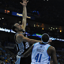 Jan 18, 2010; New Orleans, LA, USA; San Antonio Spurs guard Manu Ginobili (20) shoots over New Orleans Hornets forward James Posey (41) during the first half at the New Orleans Arena. Mandatory Credit: Derick E. Hingle-US PRESSWIRE