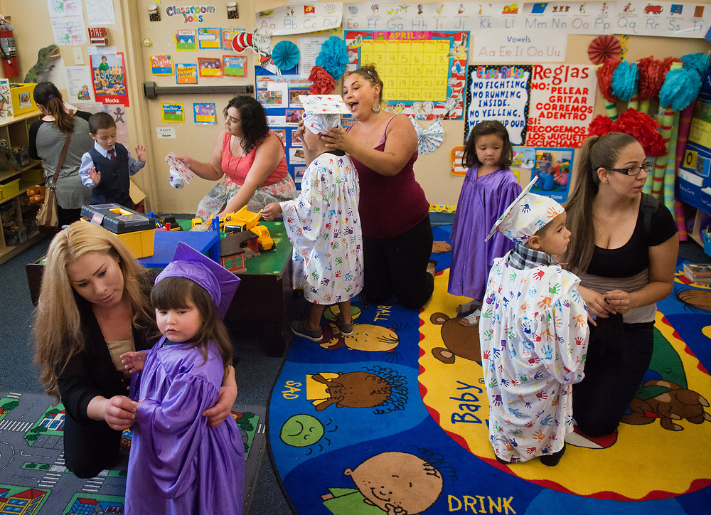 mkb072617b/metro/Marla Brose --  A group of PB&J preschoolers and their parents, who attend the preschool together, get ready for the kids' graduation, Wednesday, July 26, 2017, in Albuquerque, N.M. PB&J  is one of the programs benefitting from the county's behavioral health tax. PB&J use the money to combat adverse childhood experiences. All families throughout PB&J can benefit from the adverse childhood experiences if needed. (Marla Brose/Albuquerque Journal)