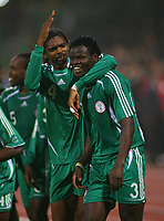 Ismaila Taiwo Taye Celebrates Scoring winning goal with Team Mate Nwankwo Kanu<br />