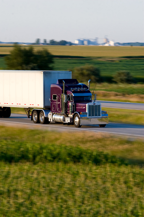 A fancy purple tractor trailer rig is speeding down I-57 in east central Illinois.