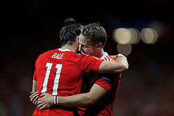 TOULOUSE, FRANCE - Monday, June 20, 2016: Wales' Gareth Bale celebrates scoring the third goal against Russia, with team-mate Chris Gunter, to seal a 3-0 victory and top Group B during the final Group B UEFA Euro 2016 Championship match at Stadium de Toulouse. (Pic by David Rawcliffe/Propaganda)