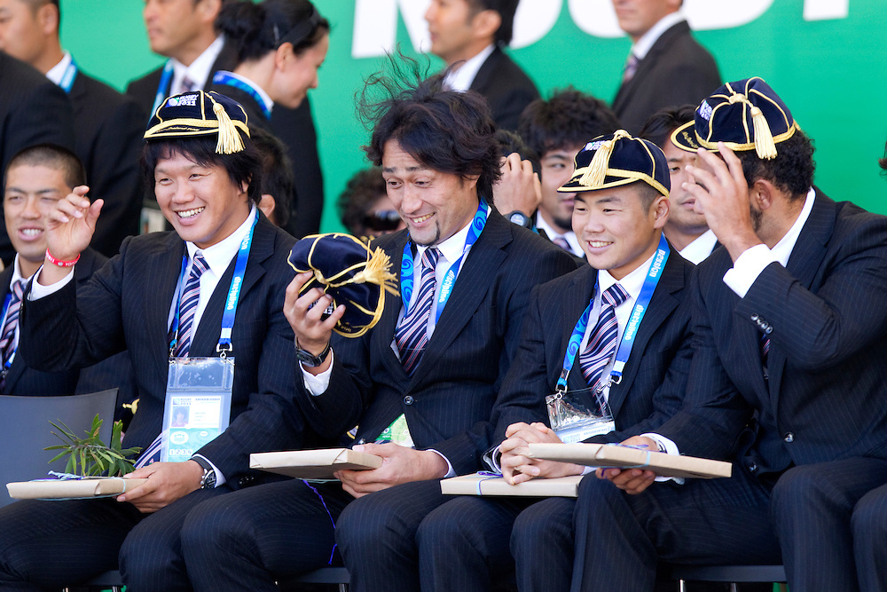 Hitoshi Ono, centre, inspects his tournament cap as members of the Japanese Rugby Team after receiving the first Rugby World Cup official welcome, Aotea Square, Auckland, New Zealand, Thursday, September 01, 2011.  Credit:SNPA / David Rowland