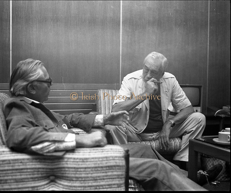 """John Huston Arrives In Dublin.   (J74)..1975..13.09.1975..09.13.1975..13th September 1975..The renowned film director,John Huston arrived in Dublin today. He had just flown in from Mexico to take part in """"Circasia 75"""" at Straffan House,Co Kildare.He is to take the part of ringmaster at the event...Picture of John McClory outlining to John Huston the position of ringmaster which he will undertake at Straffan House, Co Kildare."""