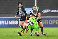 Ospreys' Dimitri Arhip is tackled by Northampton Saints' Francois van Wyk<br /> <br /> Photographer Craig Thomas/Replay Images<br /> <br /> EPCR Champions Cup Round 4 - Ospreys v Northampton Saints - Sunday 17th December 2017 - Parc y Scarlets - Llanelli<br /> <br /> World Copyright © 2017 Replay Images. All rights reserved. info@replayimages.co.uk - www.replayimages.co.uk