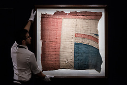 © Licensed to London News Pictures. 11/01/2018. London, UK. An exceptionally large fragment of the Union Flag which flew from HMS Victory at the Battle of Trafalgar with an estimate of £80,000-£100,000.  British national hero and legend LORD HORATIO NELSON died on the ship during the battle with the French and Spanish navies on on 21st October 1805. Photo credit: Ray Tang/LNP