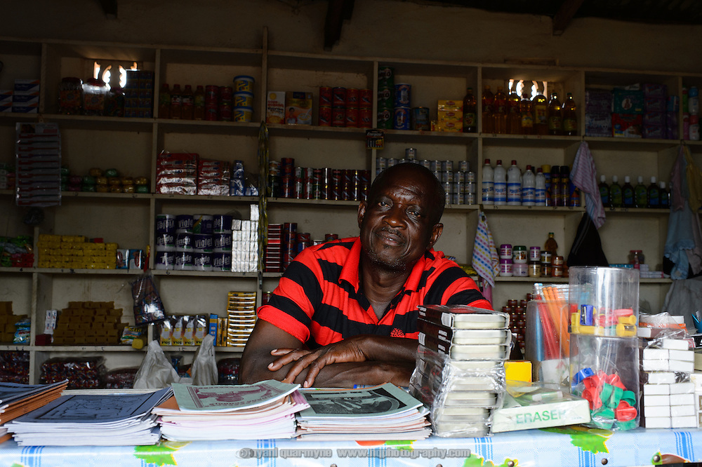 Wisdom Ziddah behind the counter of the shop he and his wife, Vincentia Dei-Zanga, own in Asiekpe in the Volta Region of Ghana.