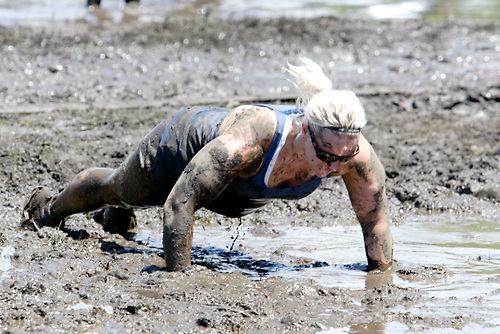 Carla Ruble of Washington Township finds that on at least one court, the ref requires push-ups for a false start on your serve during MuddyGras, the 20th annual mud volleyball for Epilepsy at Wegerzyn Gardens MetroPark in Dayton, Saturday, July 10, 2010.