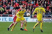 Burton Albion striker Cauley Woodrow (12) battles for possession during the EFL Sky Bet Championship match between Bristol City and Burton Albion at Ashton Gate, Bristol, England on 4 March 2017. Photo by Richard Holmes.