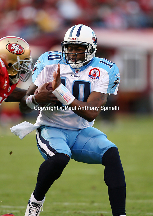 Tennessee Titans quarterback Vince Young (10) runs the ball while pursued by San Francisco 49ers linebacker Patrick Willis (52) during the NFL football game against the San Francisco 49ers, November 8, 2009 in San Francisco, California. The Titans won the game 34-27. (©Paul Anthony Spinelli)