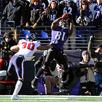 15 January 2012: Baltimore Ravens wide receiver Anquan Boldin (81) catches a 1st quarter touchdown pass against Houston Texans cornerback Jason Allen (30) in the Divisional Playoff at M&T Bank Stadium in Baltimore, MD. The Ravens defeated the Texans 20-13 to advance to the AFC Championship game..
