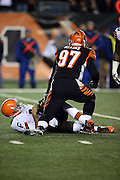 Cincinnati Bengals defensive tackle Geno Atkins (97) gets up off the ground after sacking Cleveland Browns quarterback Brian Hoyer (6) in the first quarter during the NFL week 10 regular season football game against the Cleveland Browns on Thursday, Nov. 6, 2014 in Cincinnati. The Browns won the game 24-3. ©Paul Anthony Spinelli
