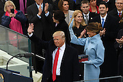 President Donald Trump and First Lady Melania Trump wave after being sworn-in as the 45th President during his Inaugural Ceremony on Capitol Hill January 20, 2017 in Washington, DC.