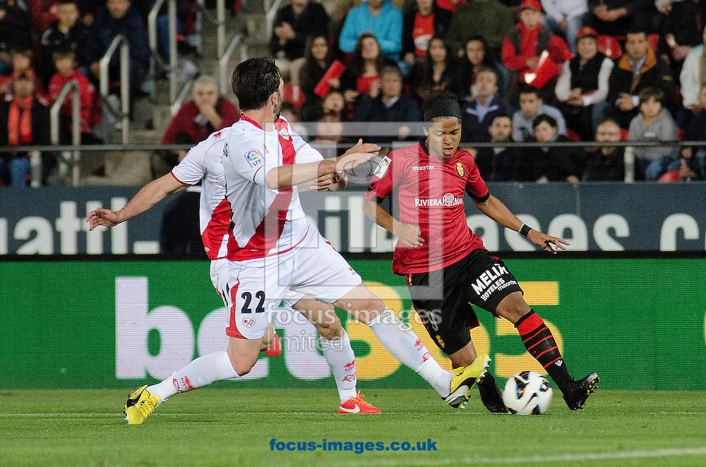 Picture by Cristian Trujillo/Focus Images Ltd +34 64958 5571.19/04/2013.Giovani Dos Santos of Real Club Deportivo Mallorca (right) and Jordi Figueras of Rayo Vallecano (left) during the La Liga match at Iberostar Stadium, Palma.