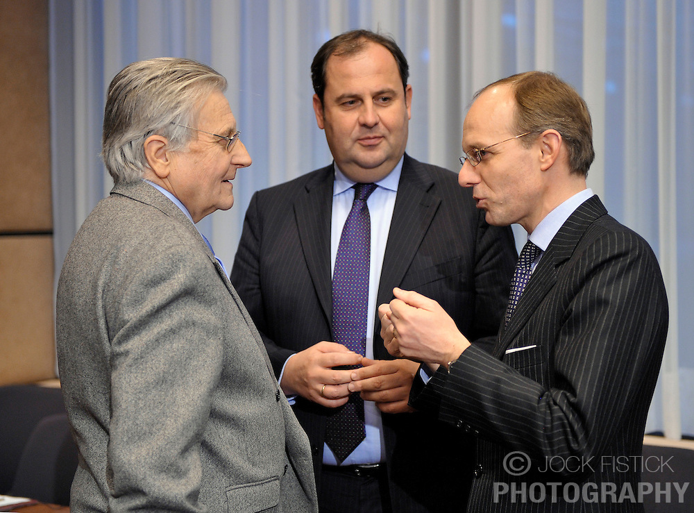 Jean-Claude Trichet, president of the European Central Bank, left, speaks with Luc Frieden, Luxembourg's finance minister, right, and Josef Proell, Austria's finance minister, center, during the Eurogroup meeting in Brussels, Belgium, on Monday, Feb. 15, 2009. (Photo © Jock Fistick)