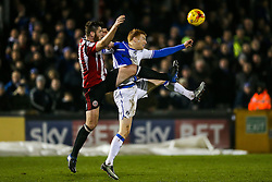 Rory Gaffney of Bristol Rovers is challenged by Jack O'Connell of Sheffield United - Rogan Thomson/JMP - 14/02/2017 - FOOTBALL - Memorial Stadium - Bristol, England - Bristol Rovers v Sheffield United - Sky Bet League One.