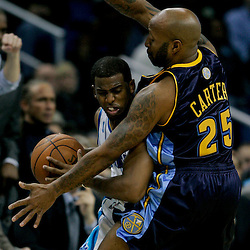Dec 18, 2009; New Orleans, LA, USA;  New Orleans Hornets guard Chris Paul (3) is guarded by Denver Nuggets guard Anthony Carter (25) during the second half at the New Orleans Arena. The Hornets defeated the Nuggets 98-92. Mandatory Credit: Derick E. Hingle-US PRESSWIRE