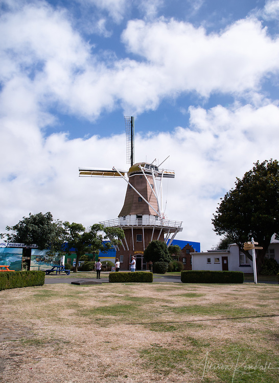 Landmarks of Foxton, New Zealand include a large windmill and nearby cafe.