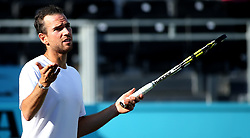 France's Adrian Mannarino complains to the referee about the crowd noise during day four of the Fever-Tree Championship at the Queen's Club, London.