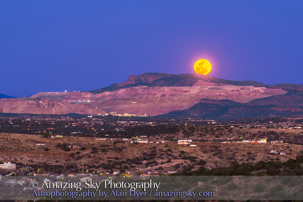 The March 5, 2015 &ldquo;mini-Moon&rdquo; rises over the Santa Rita Copper Mine, east of Silver City, New Mexico. This was the night of the farthest Full Moon of 2015, the apogee Moon. I caught the Moon as it was rising behind the Mine and the cliff formation known locally as the Kneeling Nun. <br />