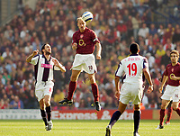 Photo: Leigh Quinnell.<br /> West Bromwich Albion v Arsenal. The Barclays Premiership.<br /> 15/10/2005. Arsenals Dennis Begkamp rises above WBAs Jonathan Greening and Curtis Davis.