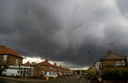 Storm clouds over suburban housing estate UK