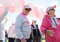 Dottie Simpson and Gayle Bettinger pass through the pink balloon arch at Opechee during Sunday's Making Strides Against Breast Cancer walk.  Simpson is a 30 year cancer survivor along with 25+ /survivors/members of the Moultonboro Women's Club.  (Karen Bobotas/for the Laconia Daily Sun)